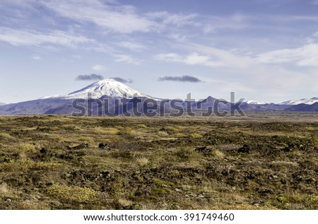 The volcano Hekla in Iceland shot in autumn, old overrgrown lavafield in the foreground - stock photo
