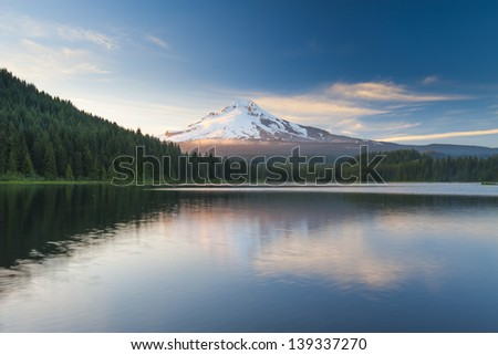 The volcano mountain Mt. Hood, in Oregon, USA. At sunset with reflection on the water of the Trillium lake. - stock photo