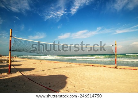 The volleyball net on the beach - stock photo