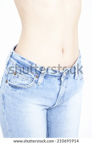 The Waist Of The Woman Wearing A Denim