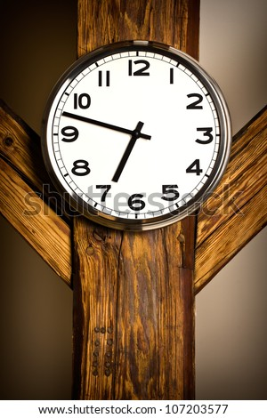 the wall clock hanging on wooden construction