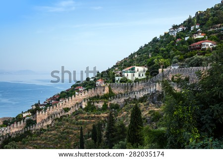 The wall of an ancient fortress on the hill in Alanya, Turkey.  - stock photo