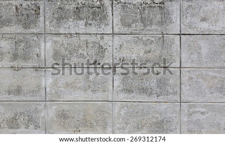 The wall of concrete decorative bricks. textural composition - stock photo