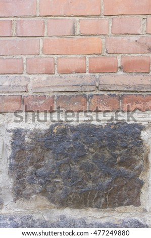 The wall of red brick and black tiles