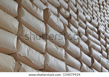 The wall of sacks in a Warehouse - stock photo