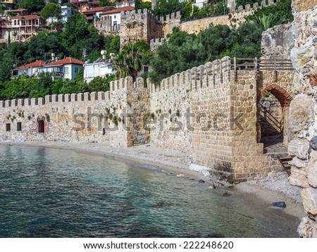 The wall of the ancient fortress at the sea coast in Alanya, Southern Turkey - stock photo