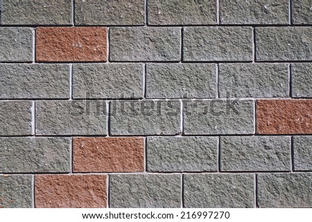 The wall of the large gray and red rectangular stones as background - stock photo