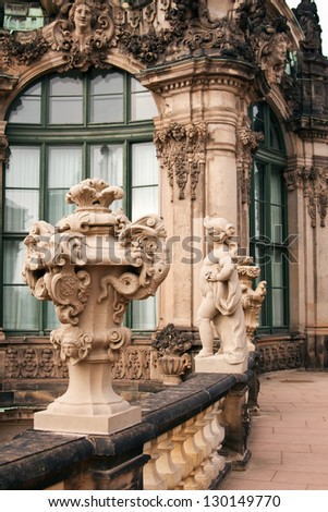 The Wall Pavilion in Zwinger with statue vase and girl - stock photo