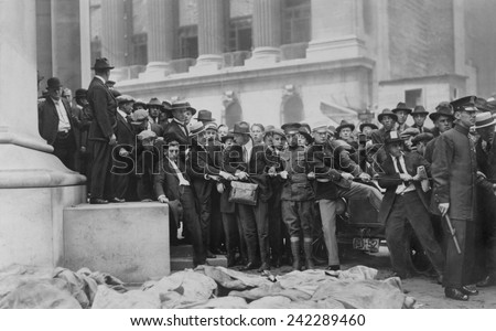 The Wall Street Bombing. Soldiers and police form a line at door of the Morgan Bank while bodies are lying in the foreground. Wall Street, in front of the Sub Treasury (Federal Hall). Sept. 16, 1920.