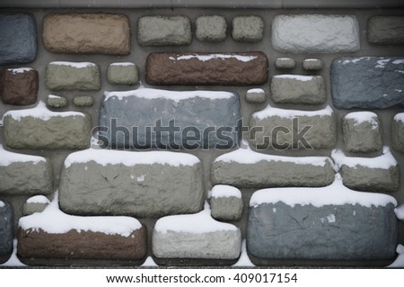 the wall with decorative imitation rubble wall - stock photo