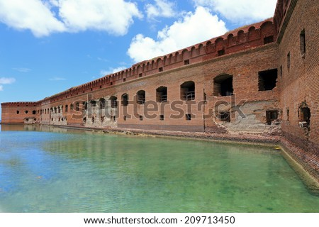 The walls of historic Fort Jefferson, in Dry Tortugas National Park, are crumbling from exposure to the elements. - stock photo