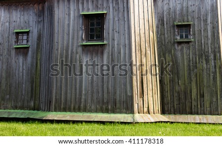 The walls of the ancient wooden church (XVIII century) from the Central Ukraine in the open-air Museum of Folk Architecture near Kyiv. - stock photo