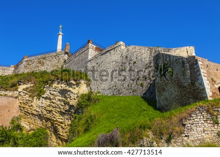 The walls of the Kalemegdan fortress and a monument to the Victor. - stock photo