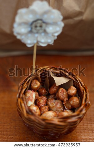 the walnuts in a brown kraft paper bag