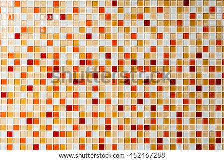 The warm tone color of the glass mosaic in abstract and random pattern