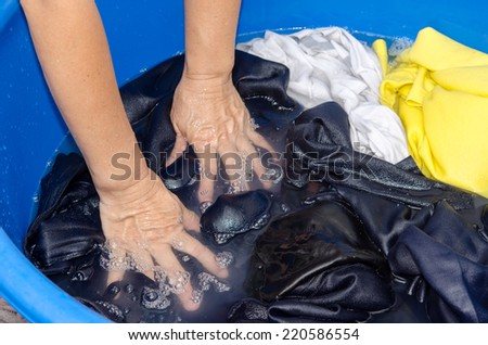 The Washing clothes in the of blue bowl - stock photo