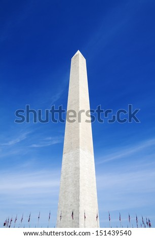 The Washington Monument surrounded with US flags in Washington D.C - stock photo
