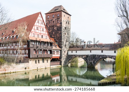 The Wasserturm (water tower, built 13th century)  and the Weinstadl (Former Wine Depot, built 15th century) - medieval buildings in historic Nuremberg - stock photo