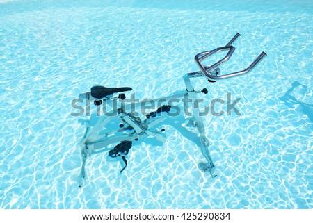 The water bicycle in swimming pool, Corfu, Greece - stock photo