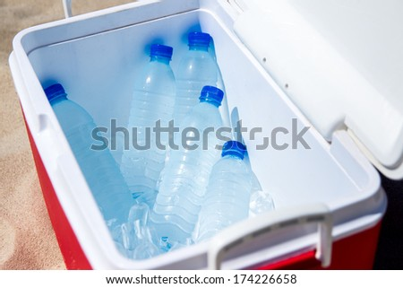 The water in the ice box on the beach - stock photo