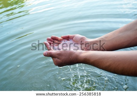 The water in the palms of man - stock photo