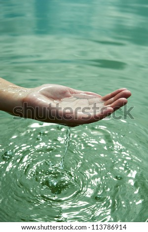 The water in the palms of women - stock photo