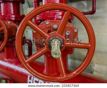 the water sprinkler system control, fire fighting pipeline, red - stock photo