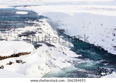 The waterfall in white snow