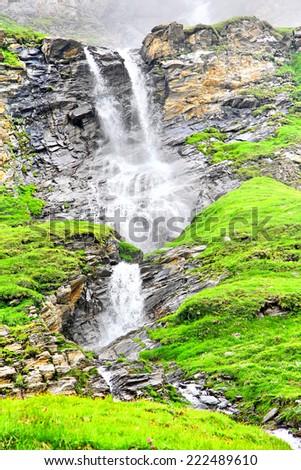 The waterfall near the Grossglockner High Alpine Road, Austria - stock photo