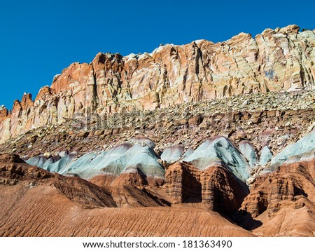 The Waterpocket Fold, a nearly one hundred mile feature in the earths crust, constitutes Capitol Reef National Park, Utah. - stock photo