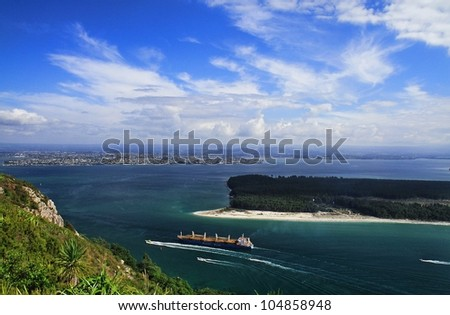 The waterstreet to the port of Tauranga, seen from the top of the Mount Maunganui in New Zealand. - stock photo