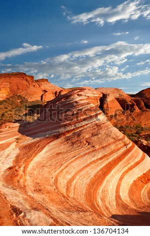 The Wave - an interesting sandstone formation in Valley of Fire State Park near Las Vegas, Nevada. - stock photo