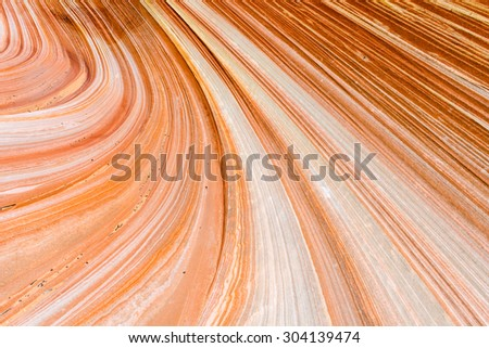The Wave is an awesome vivid swirling petrified dune sandstone formation in Coyote Buttes North. It could be seen in Paria Canyon-Vermilion Cliffs Wilderness, Arizona. USA - stock photo