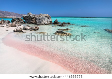 The wave of the sea on the pink sand  and  beautiful beach with cliffs.Coast of Crete island in Greece. Pink sand beach of famous Elafonisi (or Elafonissi).