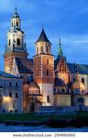 The Wawel Royal Cathedral (Polish: Katedra Wawelska, na Wawelu) by night in Krakow, Poland, city landmark dating back to the 11th century. - stock photo