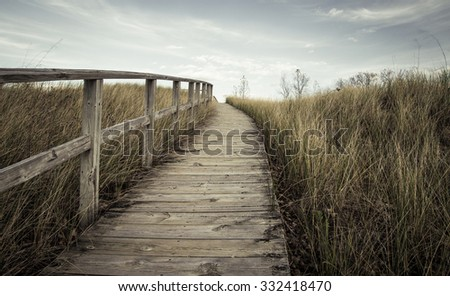 The Way Forward. Steep boardwalk trail leads to  the top of a sand dune and sweeping vistas of Lake Huron. - stock photo