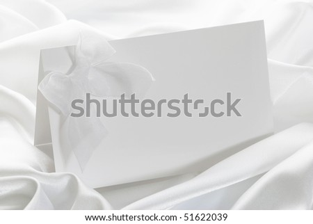 The wedding invitation with a bow on a white background