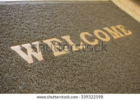 The welcome mat matted on a terrazzo floor background