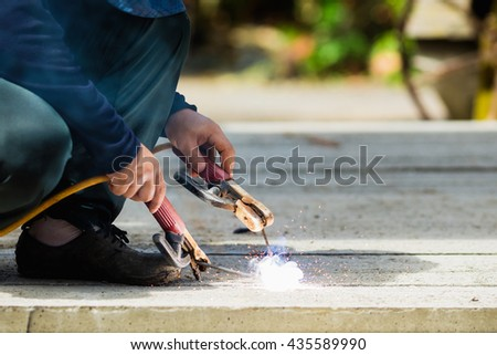 The welder mechanic technician work with out gloves, a harmful work. - stock photo