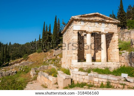 The well-preserved Athenian Treasury at the ancient site of Delphi, an old greek sanctuary and oracle - stock photo