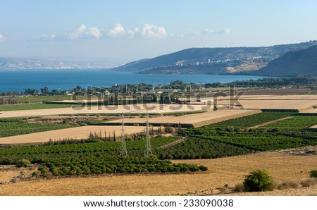 The west coast of the Lake of Galilee as seen from the north. The city in the middle on the hills is Tiberias. - stock photo