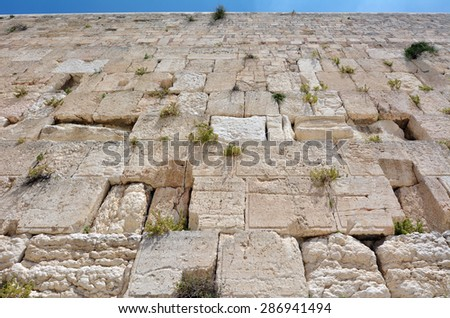 The Western Wall of the Temple Mount in Jerusalem, Israel. It's the holiest site in Judaism and is the place to which Jews turn during prayer. - stock photo