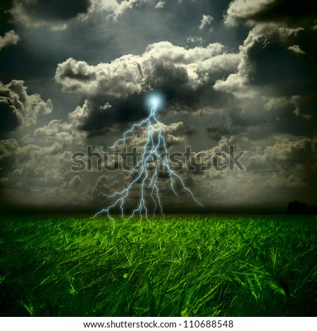 The wheat field and storm with lightnings - stock photo