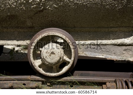 the wheel of old mine cart - stock photo
