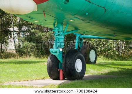 the wheel of the aircraft close up on the green chassis