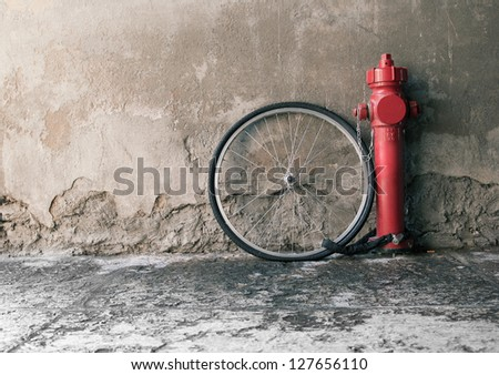 The wheel stolen wheel stays in a red fire hydrant - stock photo