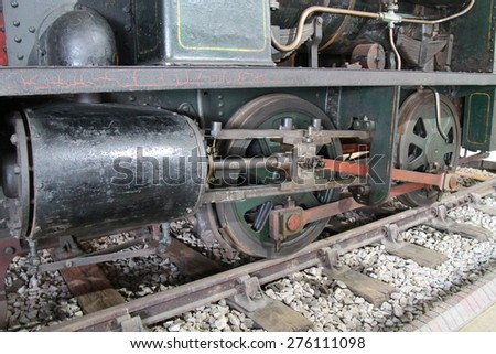 The Wheels and Piston of a Vintage Steam Train Engine. - stock photo