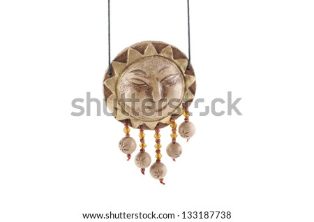 The whistle of ceramics in the form of the God of the sun from Russia. - stock photo