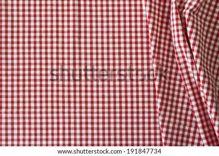 the white and red checkered tablecloth for background - stock photo