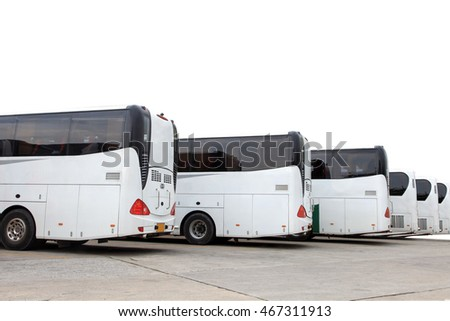 The white bus parked at the bus lot, White coach in a coach park isolated on white with path.